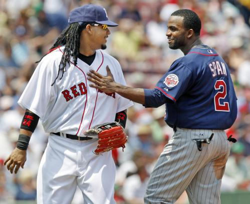 ... and when they crossed paths after the play, Span gave Ramirez a pat as they talked.