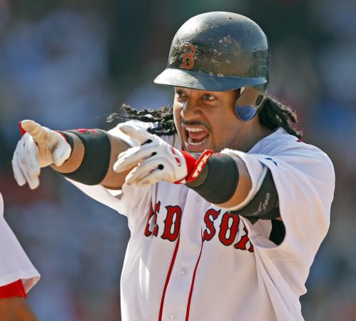 After his RBI single in the Red Sox' seven-run seventh inning, Manny Ramirez celebrated as he stood on first base and pointed to a teammate in the dugout.