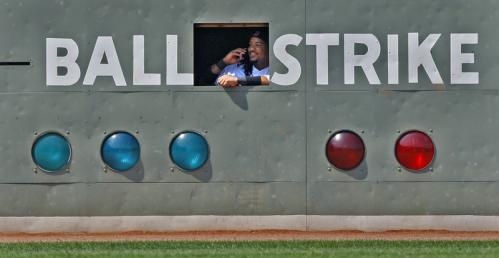 During a sixth-inning pitching change, when Red Sox starting pitcher Josh Beckett was removed from the game, Manny Ramirez went inside the left field wall and was seen smiling and apparently talking on someone's cell phone.
