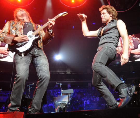 Guitarist Richie Sambora (left) and singer Jon Bon Jovi pumped out hits and pumped up the energy level at the TD Banknorth Garden last night.