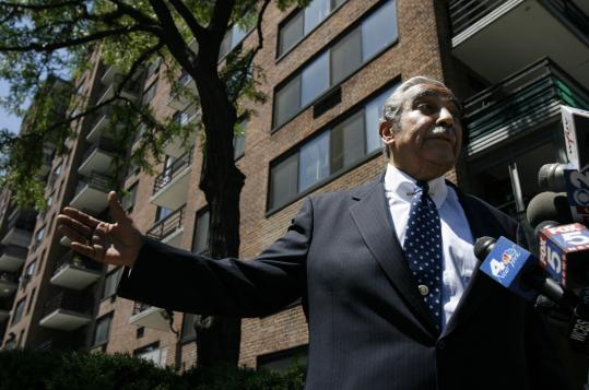 Representative Charles B. Rangel, a Democrat of New York, stood in front of his apartment building in Harlem as he responded yesterday to a report in The New York Times that he pays below-market rent for his four apartments at the complex.