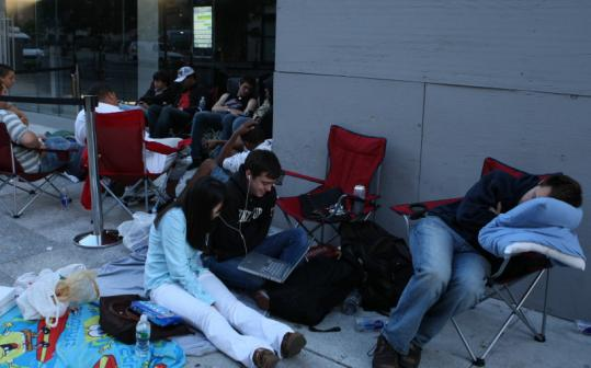 About 50 people were outside the Apple store on Boylston at 6 a.m. yesterday awaiting the 8 a.m. opening to purchase the new iPhone.