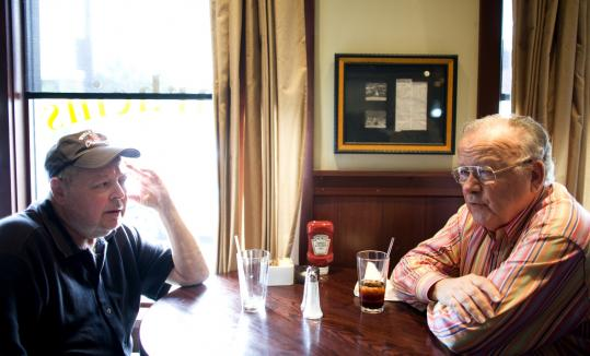 Perry King (left) and his uncle, David, talked about the state budget at Amrheins Restaurant in South Boston yesterday.