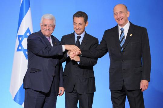 Mahmoud Abbas (from left), Nicolas Sarkozy, and Ehud Olmert at the Elysee Palace in Paris before a summit.