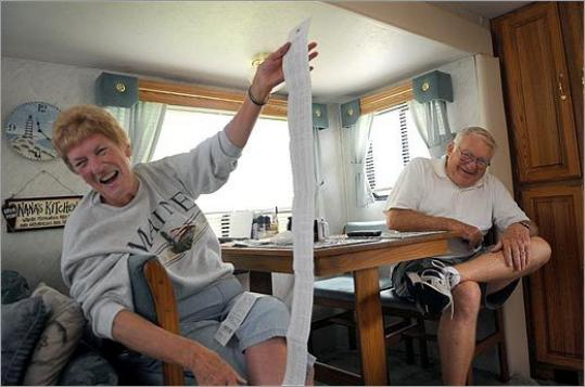 As their long receipt shows, Gladdie and Raymond Coultas limit the number of shopping runs in Maine to save fuel.