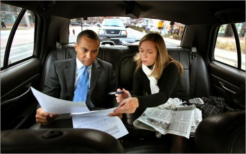 Patrick rides to the radio studio of WTKK for the first of his 'Ask the Governor' live call-in shows. He is briefed on the show and on issues in the news by deputy press secretary Cyndi Roy on Thursday, February 8, 2007.