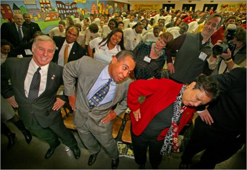 Patrick participates in a physical training demonstration led by the City Year Boston Young Heroes with DNC Chairman Howard Dean and First Lady Diane Patrick at City Year's Martin Luther King, Jr. Day celebration on Monday, January 15, 2007 at the James P. Timilty Middle School.