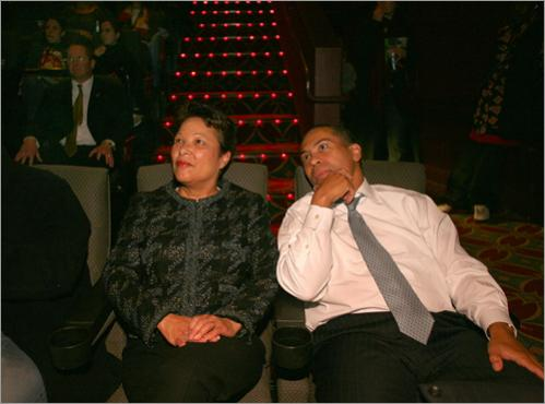 On Friday, April 13, 2007, his 100th day in office, Patrick and his wife, First Lady Diane Patrick, have their regular date night. They settle in at the AMC Boston Common 19 to see the movie 'The Namesake.' One of the State Police detail troopers is behind them (left).