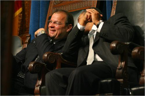 Senate President Robert E. Travaglini, left, and Patrick share a laugh as Timothy P. Cahill gives an address after he was sworn in as State Treasurer and Receiver General of the Commonwealth of Massachusetts by Patrick in the House of Representatives Chamber on Wednesday, January 17, 2007.