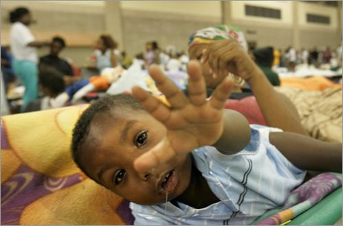 Shane Wiltz, 2, is one of the roughly 2,500-3,000 refugees from Hurricane Katrina who found refuge at the Baton Rouge River Center on Friday, September 2, 2005. Wiltz's extended family were camped out in the middle of the arena, and among the group had lost seven homes completely.