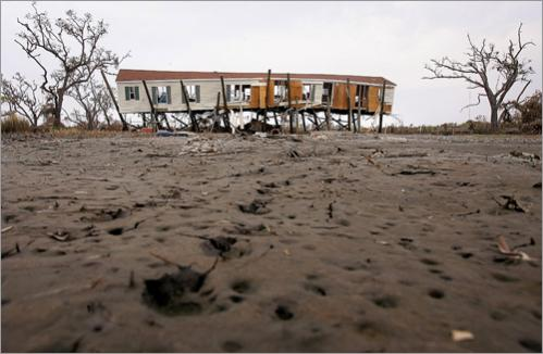 When Hurricane Katrina devastated the Gulf coast of Louisiana and Mississippi, much attention focused on New Orleans and its immediate suburbs, though the worst damage was seen to New Orleans' east. St. Bernard parish, for instance, had gone virtually unnoticed by the national media, save for a scandal involving a nursing home where 34 were found dead. Residents in St. Bernard suffered more than the severe flooding seen in New Orleans proper; the eye of Hurricane Katrina passed directly over this region, and evidence of this full-on hit is seen September 16, 2005 in splintered houses, buildings blown entirely off their foundations, and boats and cars strung up in trees.