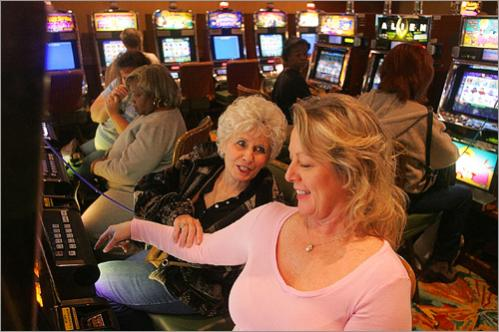 Darc Roberson of Ft. Walton Beach FL and Cecile Henderson of Pensacola FL laugh over a game at the slot machines at the Isle of Capri Casino in Biloxi Friday January 20, 2006. This was the first time Roberson had been in the casino since it was reopened.