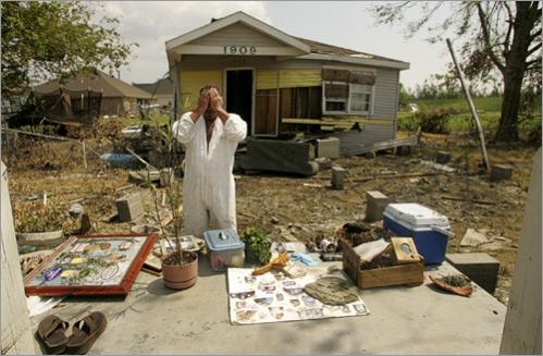 Steve Minyard stands in the place where his house once stood September 16, in Meraux, La. Spread out on the stoop are all the items which he could salvage from the wreckage left after the wind and flooding of Hurricane Katrina. Among the keepsakes Minyard was especially intent on finding were pictures of his sister who died little over a year ago. Minyard shared the house in St. Bernard Parish with his fiancee Jessica Marques Piazza and the two had returned Friday to gather their belongings. 'To some people this doesn't seem like much,' Piazza said. 'But this is all I had. All I had.' The couple does not have any insurance.