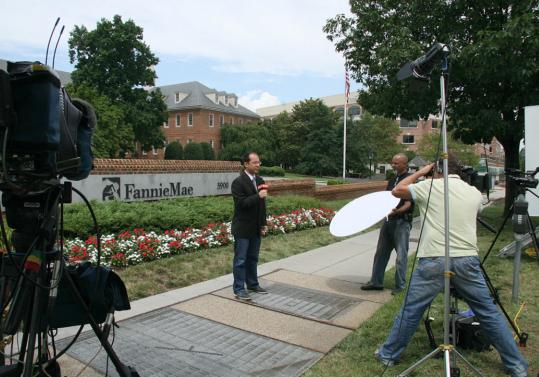 As Fannie Mae headquarters become a media backdrop yesterday, stock prices of the mortgage giants wobbled but credit markets traded as if the institutions remained on solid footing.