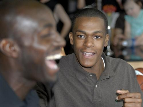 Rajon Rondo, right, gets a laugh from Kevin Garnett.