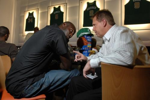 Kevin Garnett, left, talks with Danny Ainge.