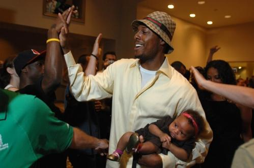 Celtics captain Paul Pierce high-5's fans while holding his 3-month-old daughter, Prianna.