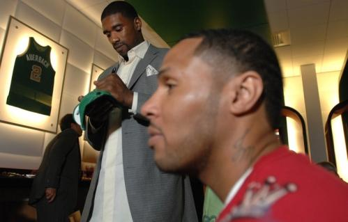 Leon Powe signs a cap as Eddie House, right, looks on at the Celtics DVD release party.