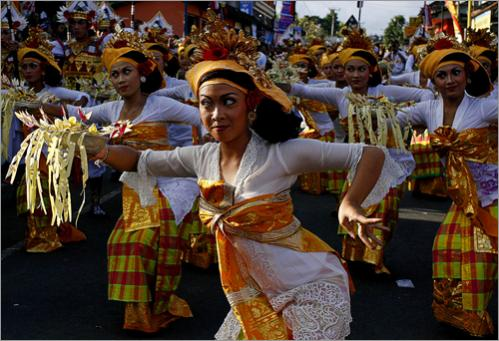 Balinese dancers perform during the procession of Pelebon in Ubud. The bodies of Ubud Royal family member Tjokorda Gde Agung Suyasa, his nephew Tjokorda Raka, his aunt Desak Raka, and 68 Ubud villagers will be cremated on July 15. The cremation ceremony is a ritual, believed by locals, to send the dead to their next lives.