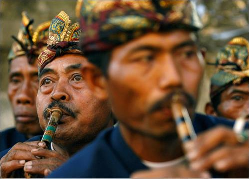 Men play 'sulings', traditional music instruments, during the procession of Pelebon. Cremations are an important ritual in predominantly Hindu Bali, marking the release of the soul from the body.