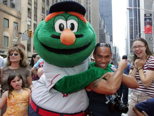 Wally the Green Monster -- official mascot for the Boston Red Sox -- poses with a fan during the MLB All-Star Game Red Carpet Parade through New York City Tuesday.