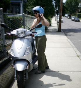 Nichole Burton of Somerville rode her moped to work at the Chestnut Hill Mall on Thursday. But where to park it?