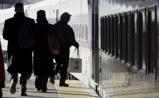 Early-morning commuters head to Boston-bound train from the Gallagher Terminal in Lowell, now the end of the line. There are increasing calls to link the line to Nashua.