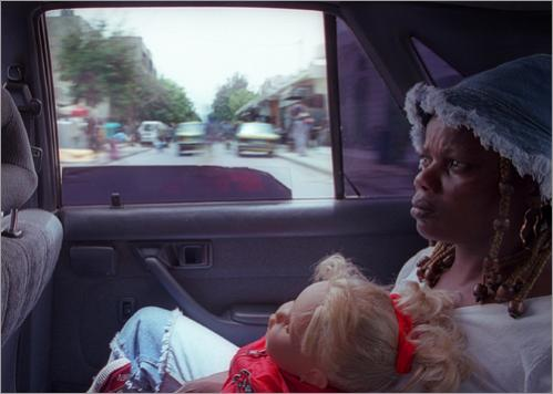 Dakar sex worker Antonia Jacob comes home from the health clinic with her large white doll, Felicia, named after her dead sister.