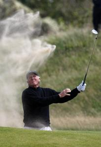 Like sands in the wind, Greg Norman's chances of winning the British Open were blown away by a final-round 77.