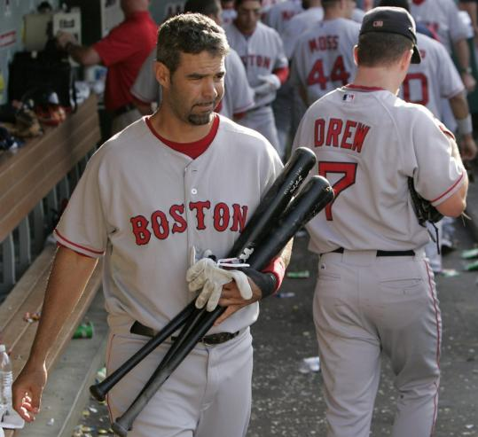 Mike Lowell grabbed his belongings - at least his bats and gloves - for the trip to Seattle.