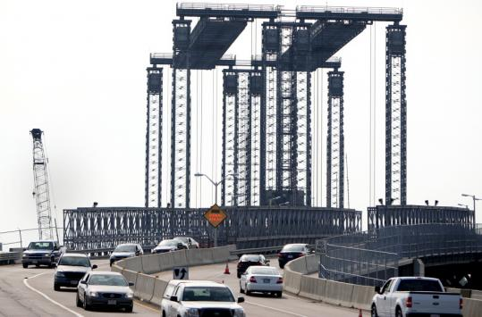 Vehicles traveled along Fore River Bridge, linking Quincy and Weymouth, last week. The vertical lift bridge has caused frustration in the community.