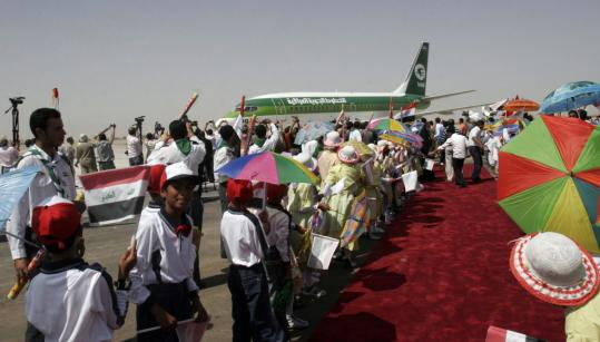 People cheered an Iraqi Airways flight that had just landed Sunday at a newly opened airport at the Shi'ite holy city of Najaf. Amid lingering dangers, Iraq is starting to promote tourism.