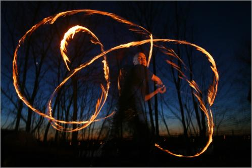 Chad Bennett is a poi (fire spinner) in Salem, MA. Every summer for the past two years he has hosted the Wildfire Festival, a three-day intensive training camp for New England fire performers, belly dancers, and drum makers.