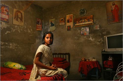 Nida Youssaf, 12, in her room in Sheikhupura, Pakistan, a mixed Christian/Muslim community outside of Lahore. She has religious pictures on her wall, she says, 'because I love Jesus.' The Christians of Pakistan are generally very poor.