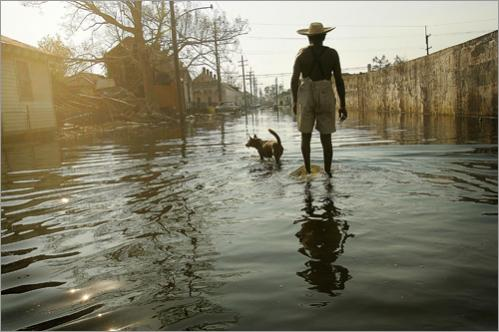 Paul Garrett, 56, and his neighbor's dog, Rusty, whom he rescued during Hurricane Kartina, walk the streets of the 9th ward in New Orleans on their way home in 2005. 'Everybody left,' said Garrett, a former longshoreman. 'I stayed.' Garrett said he stayed to help the neighborhood's elderly and sick. 'Everybody can't leave,' he said.