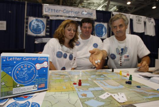 Tara and Matt Kaminski joined their father, Frank Kaminski, (right) to play the Letter Carrier Game last week in Boston.