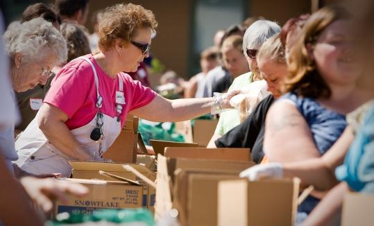 A food bank gives out supplies in Coeur D'Alene, Idaho. More than 400,000 Americans filed unemployment claims last week.