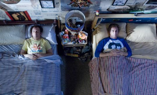 John C. Reilly (left) and Will Ferrell are grown men who have to live together when their parents get married in the gross-out comedy 'Step Brothers.'