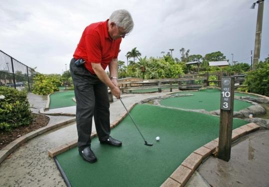 Jerry Doser, of Adventure Mini Golf, played the course in Lake Worth, Fla. Miniature golf courses are one of hundreds of areas that would be affected by proposed regulatory changes.