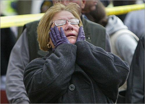 A distraught Amy Spinello reacts after returning from her brother's house on Riverside Street near the scene of the early morning explosion. She and her husband are visiting from Florida and they were not allowed to return to the home to look for her husband's medications.