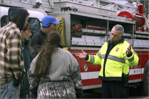 Along Water Street Sgt. Richard Stoney explains to homeowners why they can't get to their houses.
