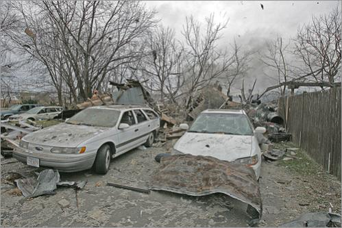 Dozens of cars were destroyed or damaged in the yards of the nearest homes.