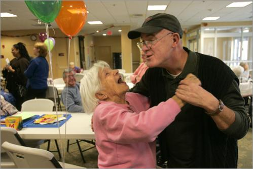 Resident Ada Zito and Father Richard Uftring dance at the New England Home for the Deaf in Danvers on January 22, 2007 after the residents returned following the explosion that forced their evacuation several months ago. Uftring's brother is a resident at the home.