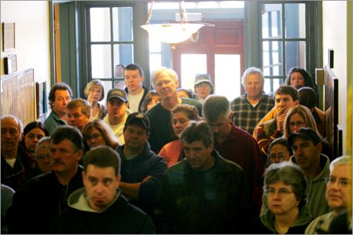 Danvers residents who were affected by the explosion listen to an update from town officials at Danvers Town Hall on the Sunday morning after the blast.