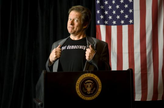 On stage, Jimmy Tingle describes his Humor for Humanity campaign and takes questions.
