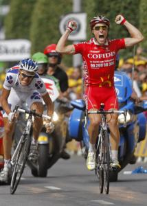 Sylvain Chavanel celebrates as he crosses the finish line to win the 19th stage of the Tour.