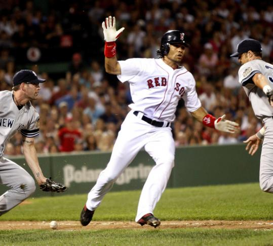 Coco Crisp made the correct call after beating out a swinging bunt in the eighth inning.