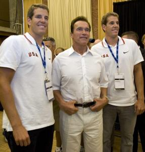 Tyler (left) and Cameron Winklevoss, posing with Arnold Schwarzenegger, hope to terminate the competition in Beijing.