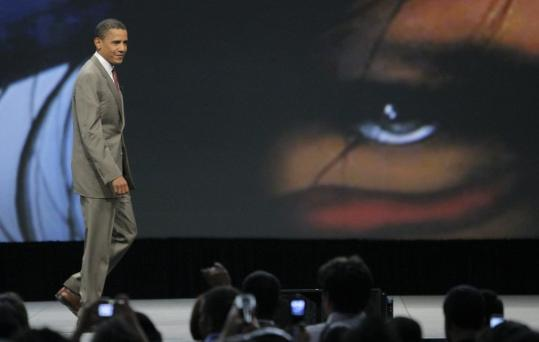 Democratic presidential candidate Barack Obama walked by a painting depicting an American Indian after participating yesterday in a forum at the Unity convention in Chicago.