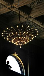 Jim Pigott of Arlington worked on a window by the chandelier in Symphony Hall in Boston yesterday.